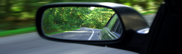 Road and Trees Viewed Through Wing Mirror